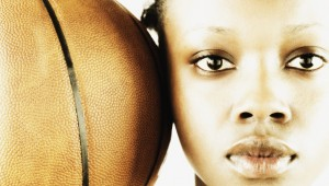Portrait of a young woman with a basketball